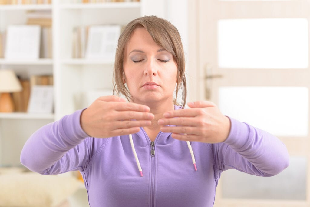 Woman relaxing with Qigong exercise