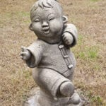 Statue of boy doing Tai Chi