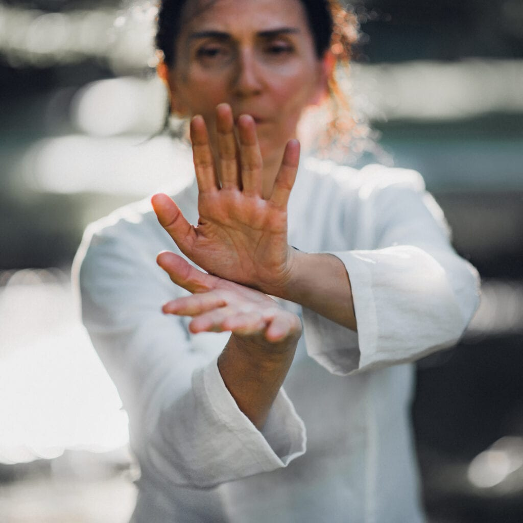 Lady practising Qigong exercise
